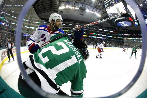 New York Rangers right wing Rick Nash, left, checks Dallas Stars left wing Antoine Roussel (21) during the first period of an NHL hockey game Monday, Feb. 5, 2018, in Dallas.