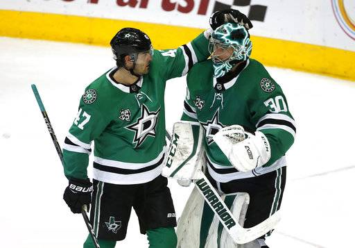 Dallas Stars right wing Alexander Radulov (47) and goaltender Ben Bishop (30) celebrate following an NHL hockey game against the New York Rangers Monday, Feb. 5, 2018, in Dallas. The Stars won 2-1.