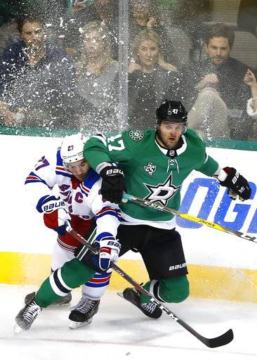 New York Rangers defenseman Ryan McDonagh (27) and Dallas Stars right wing Alexander Radulov (47) collide during the third period of an NHL hockey game Monday, Feb. 5, 2018, in Dallas. The Stars won 2-1.