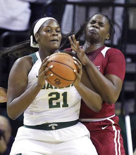 Baylor center Kalani Brown, left, tries to score past Oklahoma center Vionise Pierre-Louis, right, during the first half of an NCAA college basketball game, Monday, Feb. 5, 2018, in Waco, Texas.