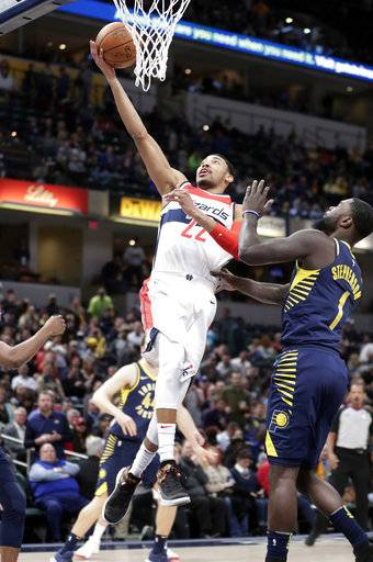 Washington Wizards forward Otto Porter Jr. (22) shoots over Indiana Pacers guard Lance Stephenson (1) during the first half of an NBA basketball game in Indianapolis, Monday, Feb. 5, 2018.