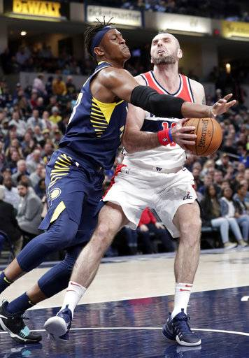 Washington Wizards center Marcin Gortat (13) is fouled by Indiana Pacers center Myles Turner (33) during the first half of an NBA basketball game in Indianapolis, Monday, Feb. 5, 2018.