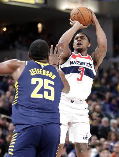 Washington Wizards guard Bradley Beal (3) shoots over Indiana Pacers center Al Jefferson (25) during the first half of an NBA basketball game in Indianapolis, Monday, Feb. 5, 2018.