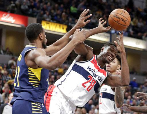 Washington Wizards center Ian Mahinmi (28) loose the ball as he attempts a shot over Indiana Pacers forward Thaddeus Young (21) during the first half of an NBA basketball game in Indianapolis, Monday, Feb. 5, 2018.