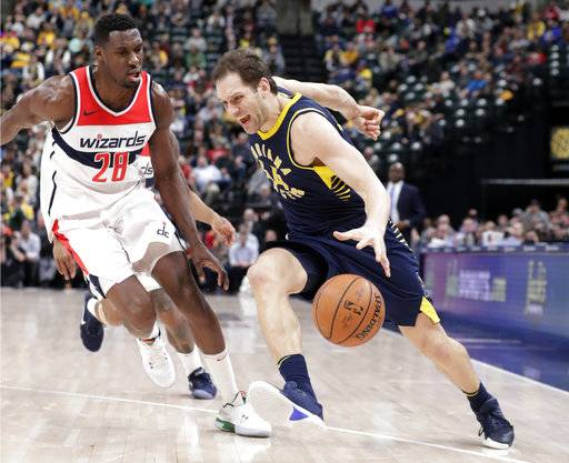 Indiana Pacers forward Bojan Bogdanovic (44) drives on Washington Wizards center Ian Mahinmi (28) during the second half of an NBA basketball game in Indianapolis, Monday, Feb. 5, 2018. The Washington Wizards defeated the Pacers 111-102.