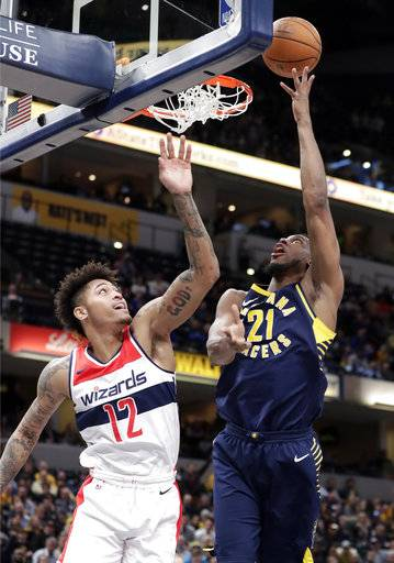 Indiana Pacers forward Thaddeus Young (21) is fouled as he shoots by Washington Wizards forward Kelly Oubre Jr. (12) during the second half of an NBA basketball game in Indianapolis, Monday, Feb. 5, 2018. The Washington Wizards defeated the Pacers 111-102.