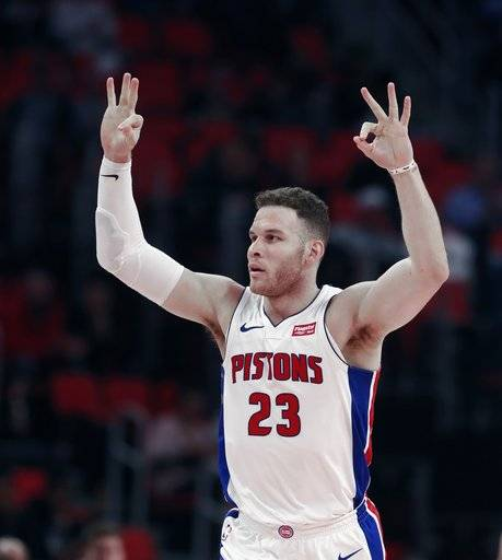 Detroit Pistons forward Blake Griffin signals after making a three-point basket during the first half of an NBA basketball game against the Portland Trail Blazers, Monday, Feb. 5, 2018, in Detroit.