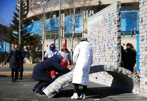 International Olympic Committee President Thomas Bach signs the Olympic Truce mural during a ceremony inside the Pyeongchang Olympic Village prior to the 2018 Winter Olympics in Pyeongchang, South Korea, Monday, Feb. 5, 2018.