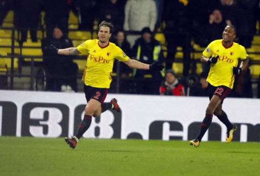 Watford's Daryl Janmaat, left, celebrates after scoring during the English Premier League soccer match between Watford and Chelsea at Vicarage Road stadium in London, Monday, Feb. 5, 2018.