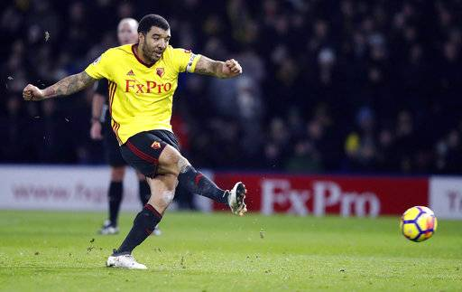 Watford's Troy Deeney scores his side's first goal from the penalty spot during the English Premier League soccer match between Watford and Chelsea at Vicarage Road stadium in London, Monday, Feb. 5, 2018.