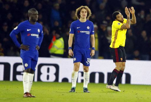 Chelsea players look dejected after their team lost the English Premier League soccer match between Watford and Chelsea at Vicarage Road stadium in London, Monday, Feb. 5, 2018.