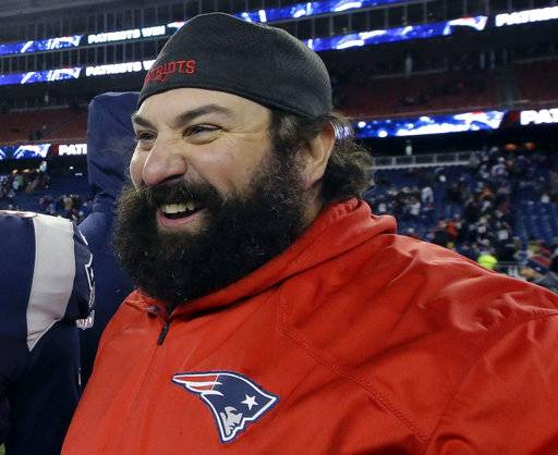 FILE - In this Jan. 13, 2018, file photo, New England Patriots defensive coordinator Matt Patricia leaves the field after an NFL divisional playoff football game against the Tennessee Titans in Foxborough, Mass. The Detroit Lions have hired Patricia as their coach. The expected hiring came a day after the Patriots lost to the Philadelphia Eagles in the Super Bowl.