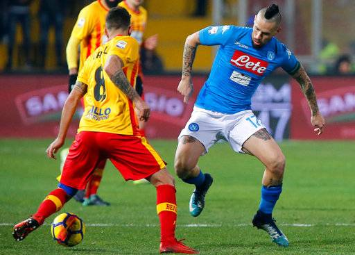 Napoli's Marek Hamsik, right, and Benevento's Danilo Cataldi vie for the ball during the Italian Serie A soccer match between Benevento and Napoli at the Ciro Vigorito stadium in Benevento, Italy, Sunday,  Feb. 4, 2018. (Mario Taddeo/ANSA via AP)