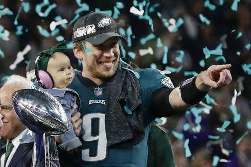 Philadelphia Eagles' Nick Foles holds his daughter, Lily, after beating the New England Patriots in the NFL Super Bowl 52 football game Sunday, Feb. 4, 2018, in Minneapolis.