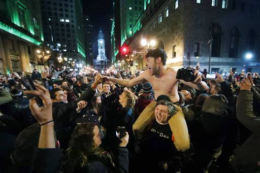 Philadelphia Eagles fans celebrate the team's victory in the NFL Super Bowl 52 between the Philadelphia Eagles and the New England Patriots, Sunday, Feb. 4, 2018, in downtown Philadelphia.