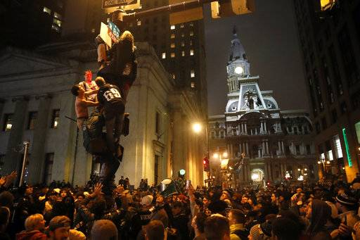 Philadelphia Eagles fans celebrate the team's victory in NFL Super Bowl 52 between the Philadelphia Eagles and the New England Patriots, Sunday, Feb. 4, 2018, in downtown Philadelphia.