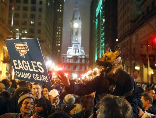 Philadelphia Eagles fans celebrate the team's victory in NFL Super Bowl 52 between the Philadelphia Eagles and the New England Patriots, Monday, Feb. 5, 2018, in downtown Philadelphia.