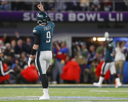 Philadelphia Eagles quarterback Nick Foles celebrates a touchdown pass to Zach Ertz during the second half of the NFL Super Bowl 52 football game against the New England Patriots Sunday, Feb. 4, 2018, in Minneapolis.