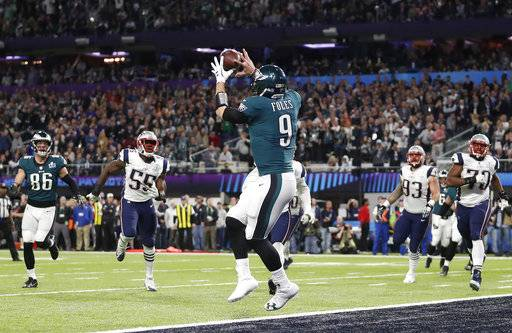 Philadelphia Eagles' Nick Foles catches a touchdown pass during the first half of the NFL Super Bowl 52 football game against the New England Patriots Sunday, Feb. 4, 2018, in Minneapolis.