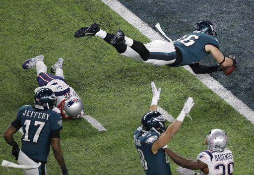 Philadelphia Eagles tight end Zach Ertz scores past New England Patriots free safety Devin McCourty during the second half of the NFL Super Bowl 52 football game Sunday, Feb. 4, 2018, in Minneapolis.