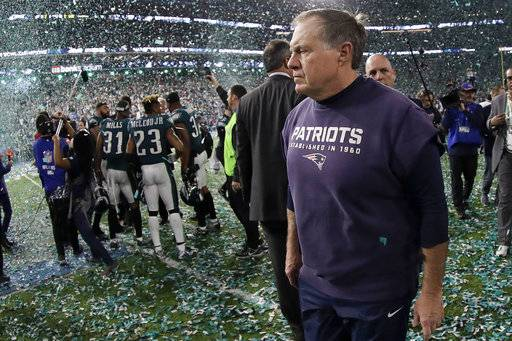 New England Patriots head coach Bill Belichick walks off the field after the NFL Super Bowl 52 football game against the Philadelphia Eagles Sunday, Feb. 4, 2018, in Minneapolis. The Eagles won 41-33.