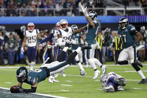 Philadelphia Eagles' Zach Ertz dives into the end zone for a touchdown during the second half of the NFL Super Bowl 52 football game against the New England Patriots Sunday, Feb. 4, 2018, in Minneapolis.