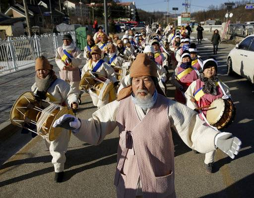 Members of a traditional Korean band march through the streets near the Pyeongchang Olympic Plaza to celebrate the upcoming 2018 Winter Olympics in Pyeongchang, South Korea, Monday, Feb. 5, 2018.
