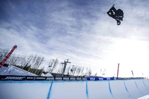 FILE - In this Jan. 13, 2018, file photo, Shaun White makes a practice run before men's snowboard halfpipe finals at Snowmass, Colo. White has redoubled his effort on the halfpipe. And in the end, one thing really hasn't changed. He is still the biggest name in his sport, and all eyes will still be on him when the gold medal is at stake in Pyeongchang on Feb. 14. (Anna Stonehouse/The Aspen Times via AP, File)