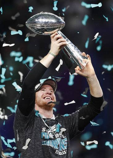 Philadelphia Eagles' Carson Wentz holds up the Vince Lombardi Trophy after the NFL Super Bowl 52 football game against the New England Patriots, Sunday, Feb. 4, 2018, in Minneapolis. The Eagles won 41-33.