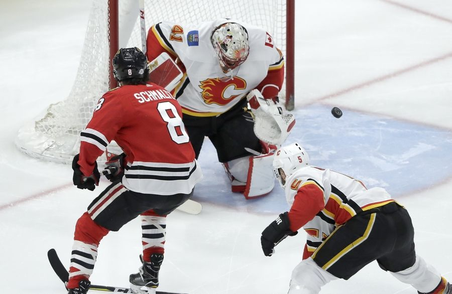 The Blackhawks showed consistency for large chunks of Tuesday's game, but the Flames overcame an early Alex DeBrincat goalto beat the Hawks 3-2, for the second time in four days.