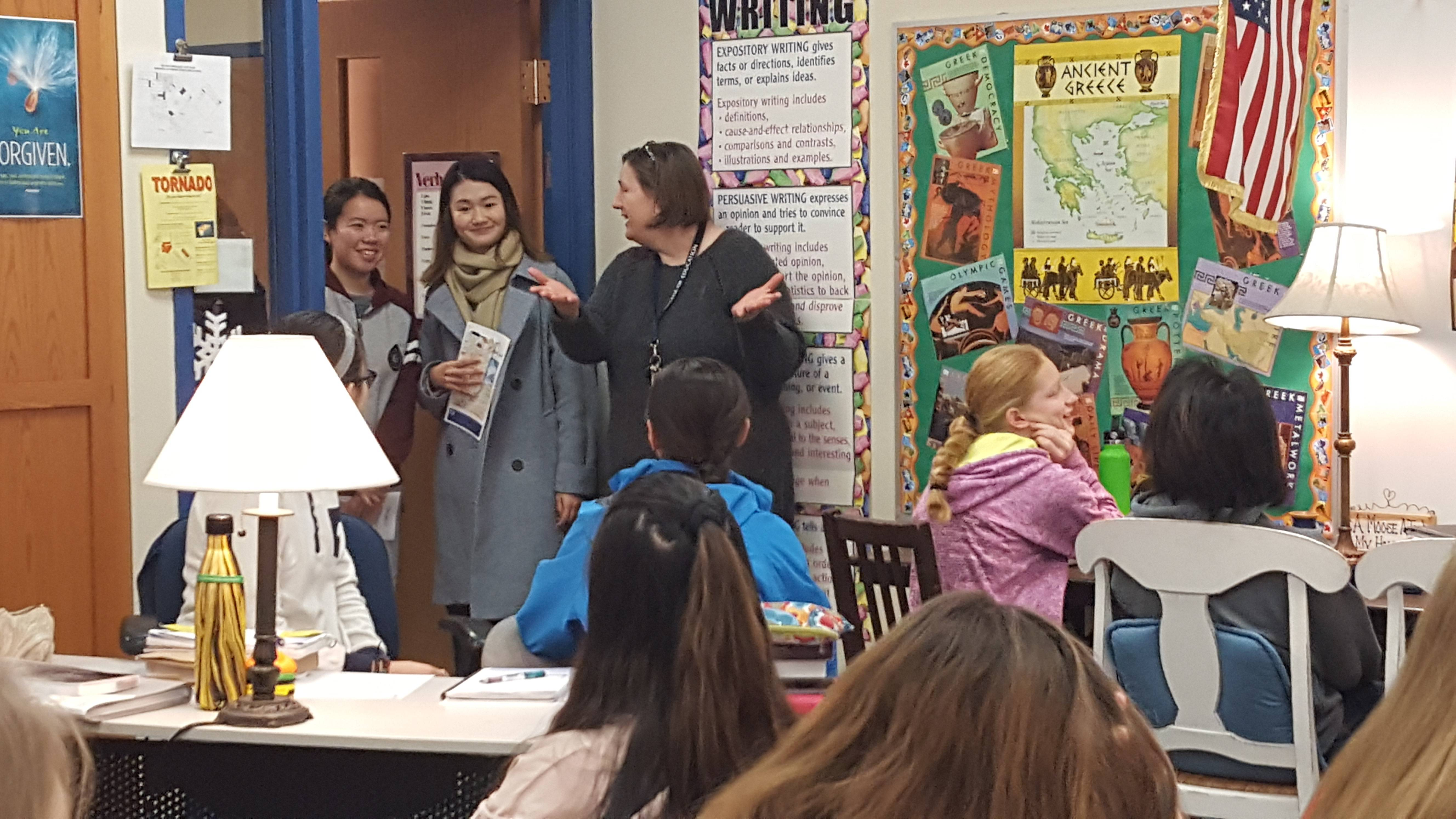 Immanuel Lutheran School Principal Donna Laughlin introduces the Chinese exchange teachers to eighth-graders during a preview visit last week.