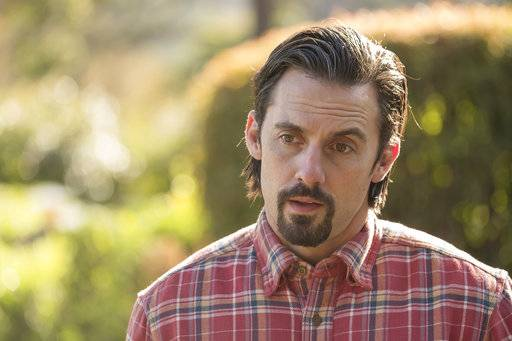 "In this image released by NBC, Milo Ventimiglia appears in a scene from ""This Is Us."" Super Bowl ratings may have been slightly down for NBC, but the network's entertainment division was buoyed by the showing of ""This is Us"" after the game. The second-year drama scored just under 27 million people. (Ron Batzdorff/NBC via AP)"