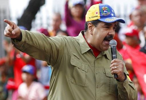 Venezuela's President Nicolas Maduro addresses supporters during a rally marking the anniversary of the 1992 failed coup led by late President Hugo Chavez in Caracas, Venezuela, Sunday, Feb. 4, 2018. Maduro will run for reelection in this year's presidential election.
