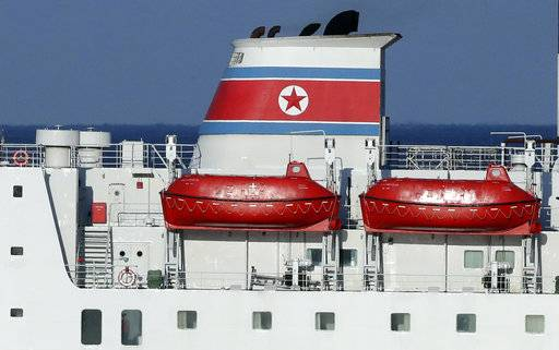 A North Korean flag is seen on North Korea's Mangyongbong-92 ferry carrying a 140-member art troupe  as its approaches to Mukho Port in Donghae, South Korea, Tuesday, Feb. 6, 2018. The art troupe, led by Hyon Song Wol, also the leader of the famous Moranbong girl band hand-picked by North Korean leader Kim Jong Un, will perform in Gangneung and Seoul on Feb. 8 and Feb. 11, respectively, before returning home.