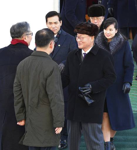 ADDS TROUPE'S LEADER NAME HYON SONG WOL - Members of the North Korean arts troupe and the troupe's leader, Hyon Song Wol, right, arrive at the Mukho port in Gangwon-do province, South Korea, Wednesday, Feb. 7, 2018. The troupe's visit is to coincide with the Pyeongchang 2018 Olympic Games that start Feb. 9. (Song Kyeong-seok, Kyodo News/Pool Photo via AP)