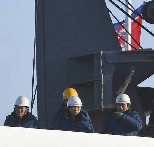 Crew members of North Korean ship Mangyongbong-92 carrying art troupe members arrive at Mukho port in Donghae, South Korea Tuesday, Feb. 6, 2018. The art troupe, led by Hyon Song Wol, also the leader of the famous Moranbong girl band hand-picked by North Korean leader Kim Jong Un, will perform in Gangneung and Seoul on Feb. 8 and Feb. 11, respectively, before returning home. (Song Kyung-Seok/Pool Photo via AP)