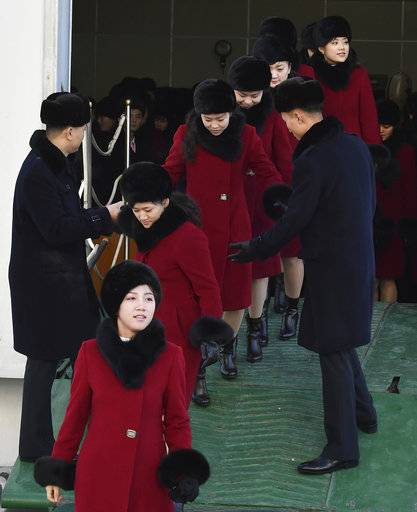 Members of the North Korean arts troupe arrive at the Mukho port in Gangwon-do province, South Korea, Wednesday, Feb. 7, 2018. The troupe's visit is to coincide with the Pyeongchang 2018 Olympic Games that start Feb. 9. (Song Kyeong-seok/Kyodo News/Pool Photo via AP)