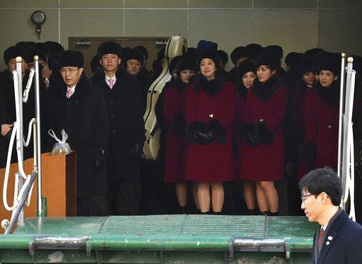 Members of the North Korean arts troupe prepare to disembark for their ship at the Mukho port in Gangwon-do province, South Korea, Wednesday, Feb. 7, 2018. The troupe's visit is to coincide with the Pyeongchang 2018 Olympic Games that start Feb. 9. (Song Kyeong-seok, Kyodo News/Pool Photo via AP)