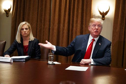 Secretary of Homeland Security Kirstjen Nielsen listens as President Donald Trump speaks during a meeting with law enforcement officials on the MS-13 street gang and border security, in the Cabinet Room of the White House, Tuesday, Feb. 6, 2018, in Washington.