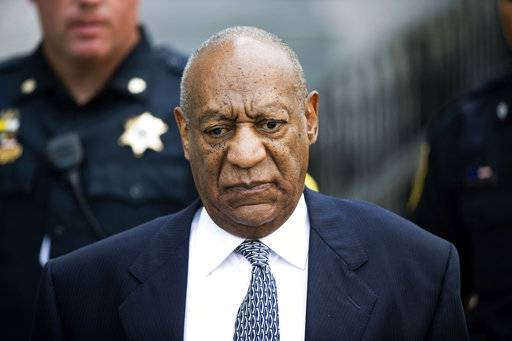 FILE - In this Aug. 22, 2017, file photo, Bill Cosby leaves Montgomery County Courthouse after a hearing in his sexual assault case in Norristown, Pa. Cosby's lawyers said in a court filing Tuesday that they'll seek a delay to allow them more time to investigate allegations from the 19 women prosecutors are seeking to call as witnesses.