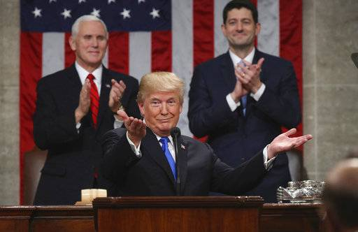"FILE - In this Jan. 30, 2018, file photo, President Donald Trump gestures as delivers his first State of the Union address in the House chamber of the U.S. Capitol to a joint session of Congress in Washington, as Vice President Mike Pence and House Speaker Paul Ryan applaud. Less than a week ago, Trump stood before the nation and called for a new era of bipartisan cooperation. ""Tonight, I call upon all of us to set aside our differences, to seek out common ground, and to summon the unity we need to deliver for the people we were elected to serve,� he said, extolling how the country had come together in recent times of tragedy. A week later, such talk is but a distant memory. (Win McNamee/Pool via AP, File)"