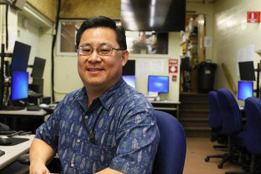 "In this Feb. 1, 2018 photo, Jeffrey Wong, current operations officer for the Hawaii Emergency Management Agency, poses for a photo in Honolulu. He filed a police report after seeing threatening comments online from people who confused him with being the agency employee who mistakenly sent a missile alert. He wants to set the record straight that he's not the so-called ""button-pusher"" and was on a different island when the alert was sent from Honolulu on Jan. 13."