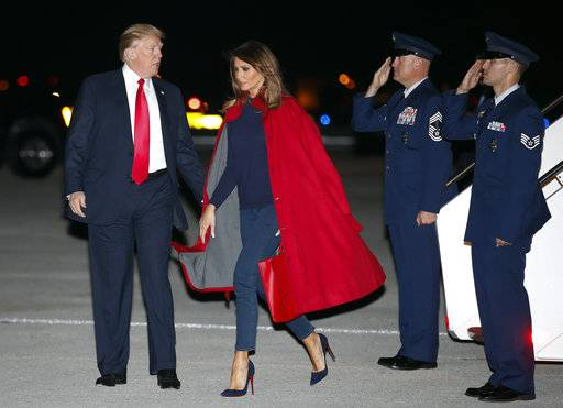 President Donald Trump and first lady Melania Trump arrive on Air Force One at Palm Beach International Airport, in West Palm Beach, Fla., Friday, Feb. 2, 2018.