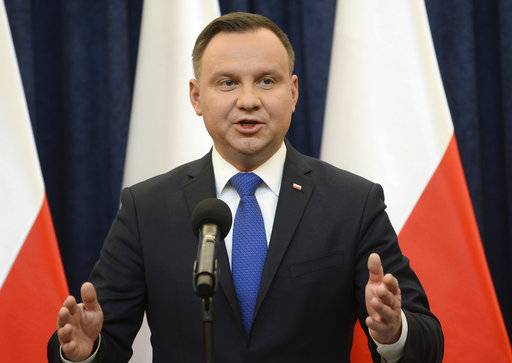 Polish President Andrzej Duda announces his decision to sign a legislation penalizing certain statements about the Holocaust, in Warsaw, Poland, Tuesday, Feb. 6, 2018. Duda said that he will also ask the constitutional court to make final ruling on the disputed Holocaust speech bill.