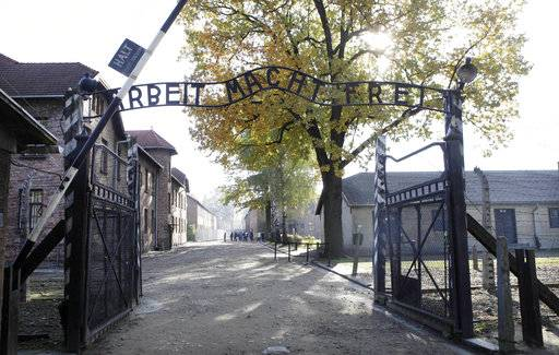 FILE - This Oct. 19, 2012 file photo shows the gate of the former Nazi death camp of Auschwitz in Oswiecim, Poland. The office of Polish President Andrzej Duda said the leader will on Tuesday, Feb. 6, 2018 announce his decision on whether to sign legislation penalizing certain statements about the Holocaust.