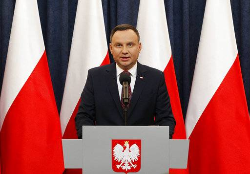 FILE - In this Dec. 20, 2017 file photo Poland's President Andrzej Duda tells a news conference he has decided to sign into law two divisive bills that are part of the overhaul of the European Union nation's justice system, in Warsaw. The office of Polish President Andrzej Duda said the leader will on Tuesday, Feb. 6, 2018 announce his decision on whether to sign legislation penalizing certain statements about the Holocaust.