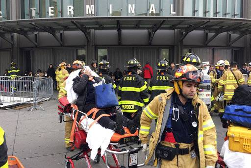 FILE - In this Jan. 4, 2017 file photo, an injured passenger is taken from the Atlantic Terminal in the Brooklyn borough of New York after a Long Island Rail Road train hit a bumping block. The National Transportation Safety Board is meeting Tuesday, Feb. 6, 2018 and plans to release the probable causes of the Brooklyn crash.