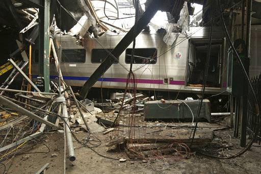 "FILE â€"" This Oct. 1, 2016, file photo provided by the National Transportation Safety Board shows damage from a Sept. 29, 2016, commuter train crash that killed a woman and injured more than 100 people at the Hoboken Terminal in Hoboken, N.J. The National Transportation Safety Board is meeting Tuesday, Feb. 6, 2018 and plans to release the probable causes of the Hoboken Terminal crash and the January 2017 crash of a Long Island Rail Road train in Brooklyn. (Chris O'Neil/National Transportation Safety Board via AP, File)"