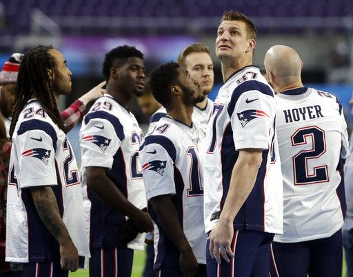 New England Patriots tight end Rob Gronkowski (87) looks around U.S. Bank Stadium before the team photo is made Saturday, Feb. 3, 2018, in Minneapolis. The Patriots are scheduled to face the Philadelphia Eagles in the NFL Super Bowl 52 football game Sunday, Feb. 4.