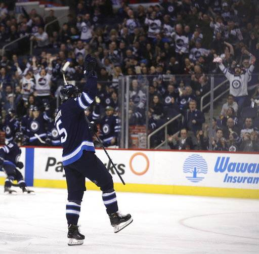 Winnipeg Jets' Dmitry Kulikov (5) celebrates after scoring against the Arizona Coyotes' during second period NHL hockey action in Winnipeg, Manitoba Tuesday, Feb. 6, 2018. (Trevor Hagan/The Canadian Press via AP)